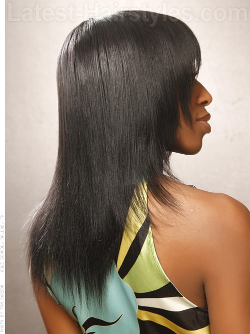 A long jet black sleek haircut side view