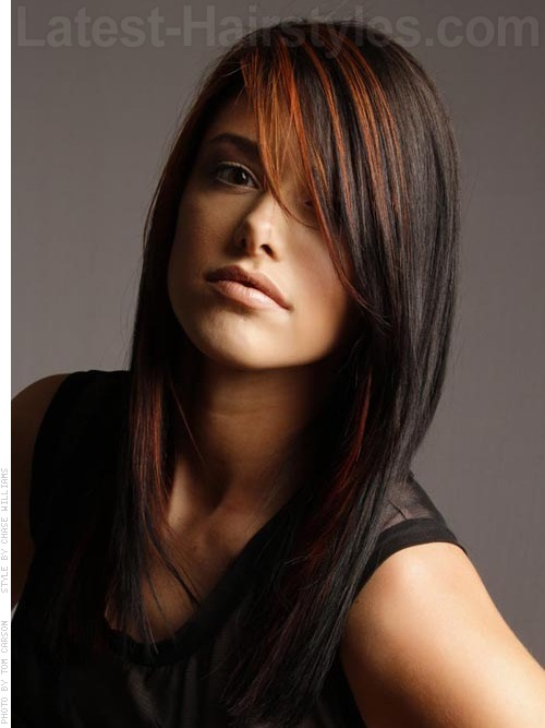 A long red and black sleek hairstyle