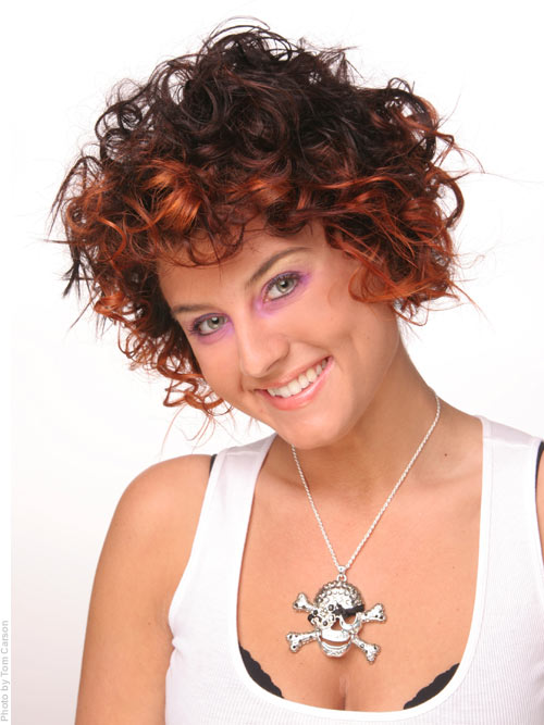 Short curly hairstyle with ombre color