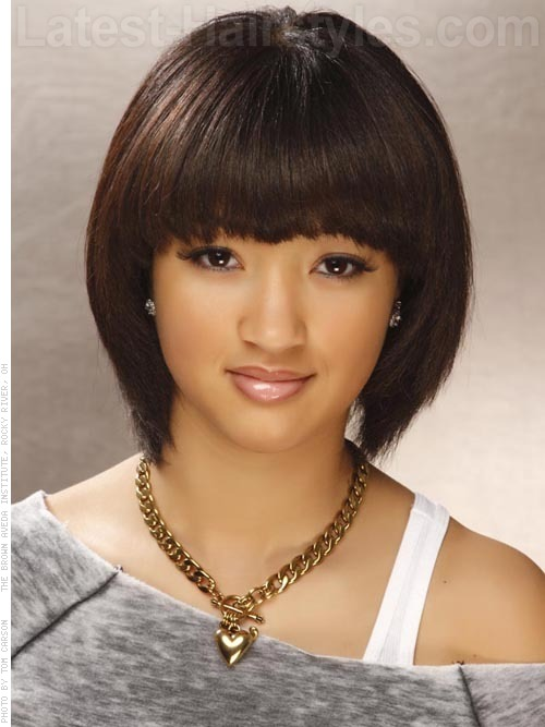 Dark hair color in short bob with thick bangs