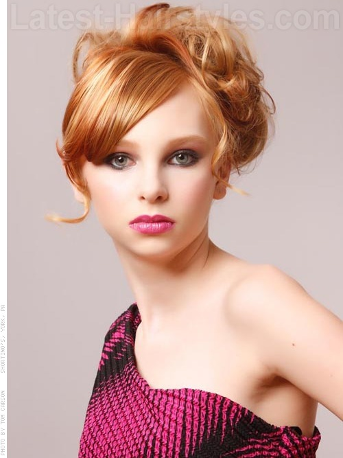 Teen with red hair color & blonde highlights