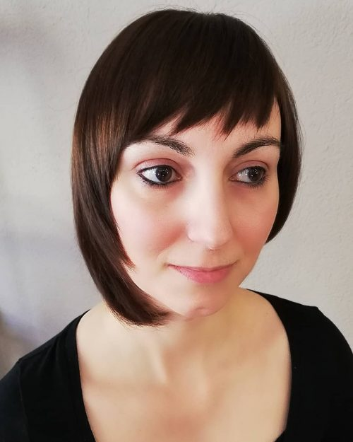 Asymmetrical bangs on short hair