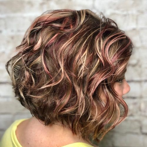 Curly Light Brown Hair with Highlights