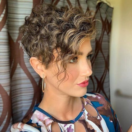 A cute curly pixie cut with bangs
