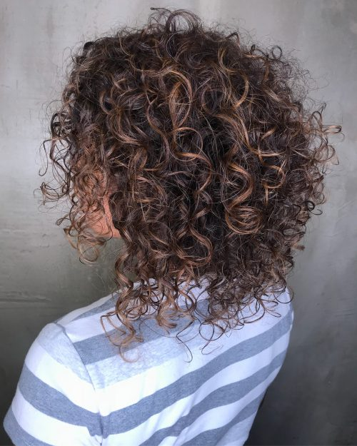 Dark brown medium length curly hair