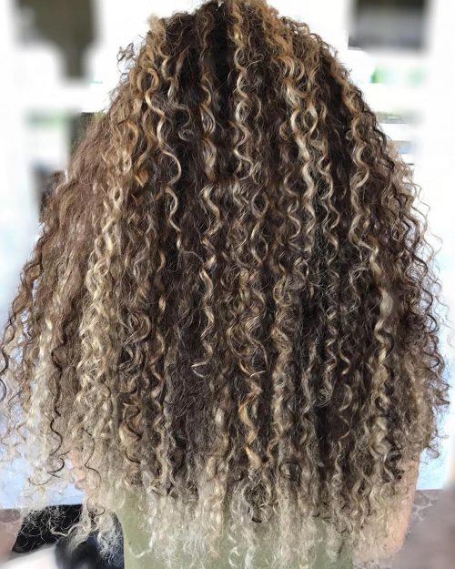 Blonde hair balayage highlights on curly hair