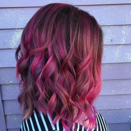 A fun and outgoing magenta red hair color