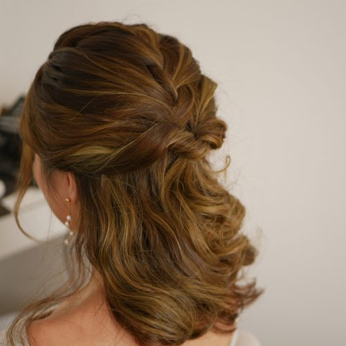 Picture of medium half up twists hairstyle for prom