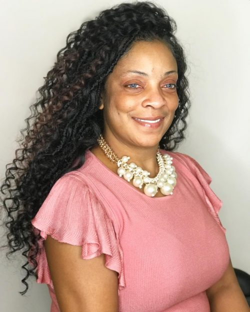 long hairstyle for black woman over 50