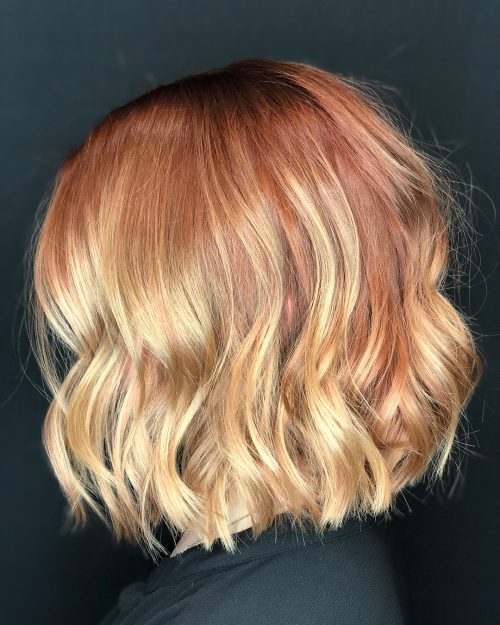 A strawberry blonde ombre hair color