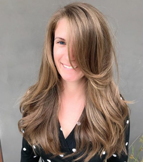 long layered hair with swoop bangs