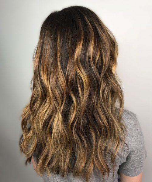 Honey balayage highlights on dark brown hair